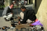 The local shoemaker outside the hospital is fixing my belt